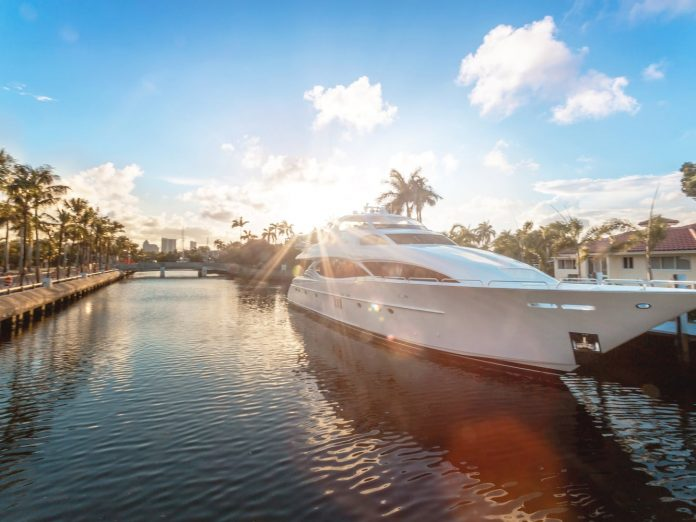 Boat surrounded by palm trees at the Miami International Boat Show