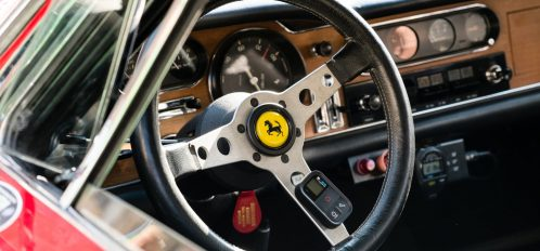 View of steering wheel inside a rare 1965 Ferrari sports car at the Fort Lauderdale Swap Shop and Fort Lauderdale Ferrari Museum