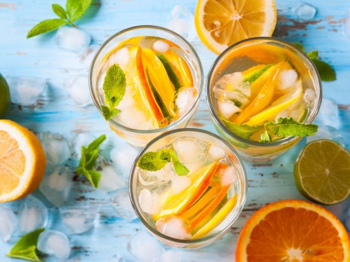 Three yellow drinks with citrus garnishes at one of the best Las Olas bars