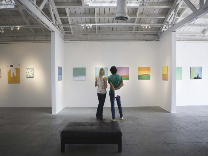 Couple looking at painting in art gallery