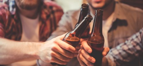 Friends toasting beer in hipster Fort Lauderdale