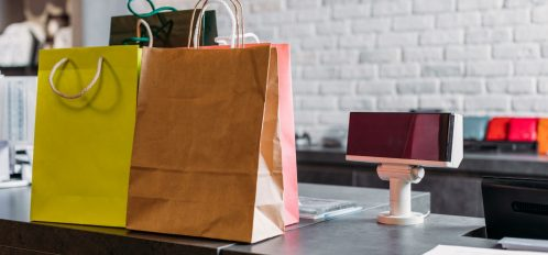 shopping bags at a cash register