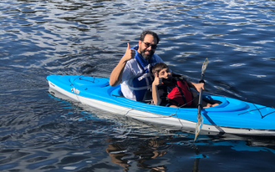 man and boy in a kayak