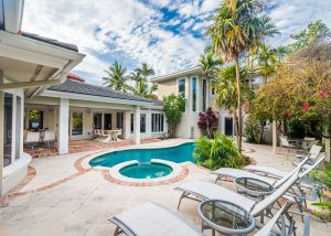 vacation rental exterior with pool and palm trees