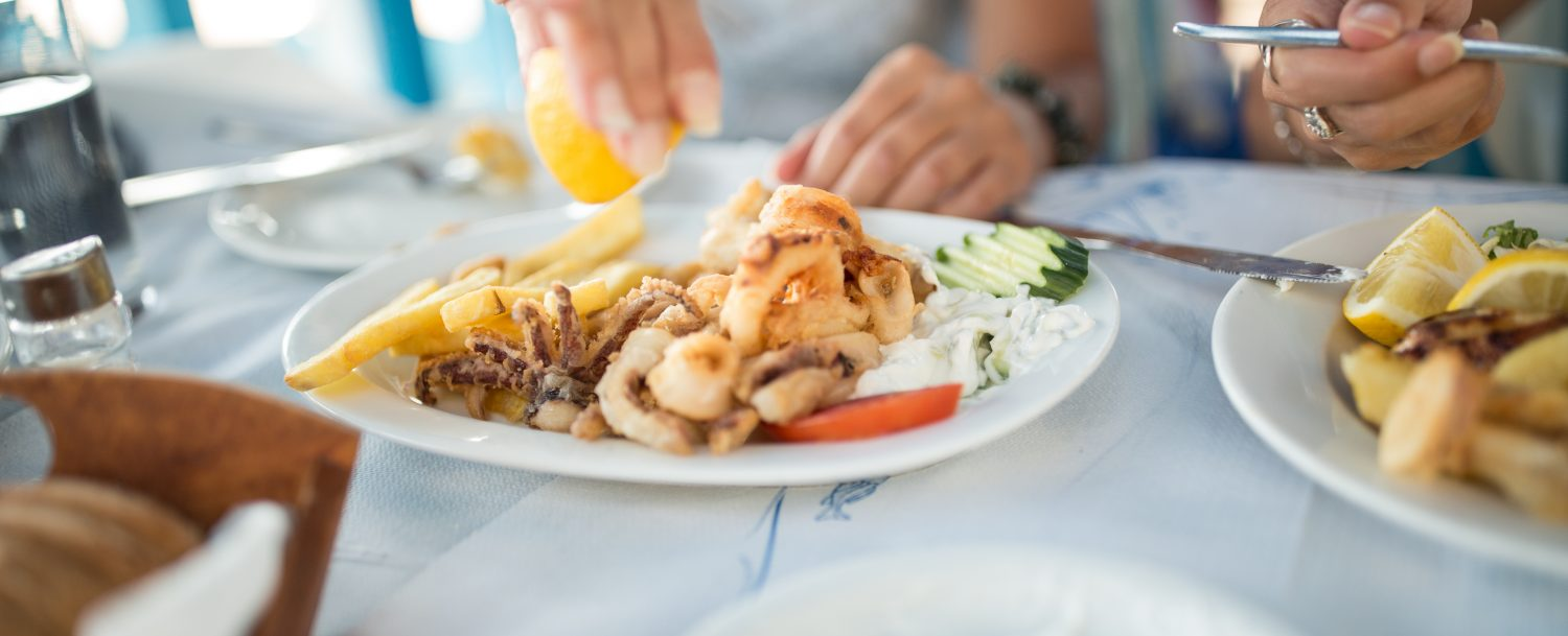 Woman squeezing lemon on seafood at a restaurant in Fort Lauderdale