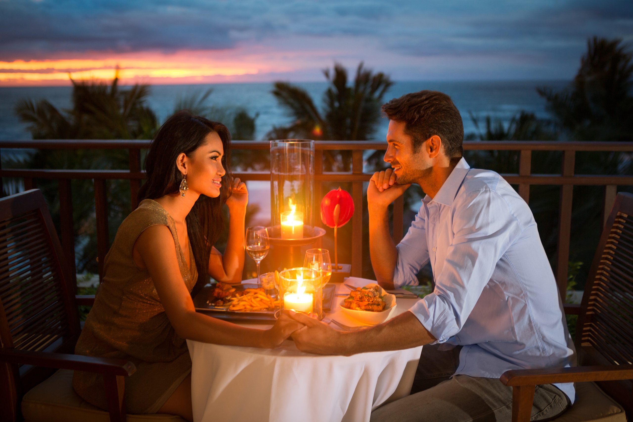 Couple holding hands at a romantic restaurant in Fort Lauderdale